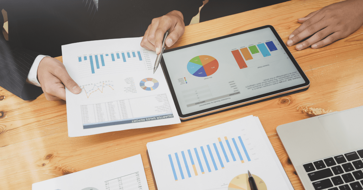 spreadsheets and charts representing business metrics